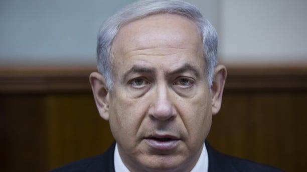 "Israel's Prime Minister Benjamin Netanyahu attends the weekly cabinet meeting on June 16, 2013 in Jerusalem. Netanyahu warned world powers on Tuesday against holding ""drawn out"" negotiations with Iran on its nuclear programme following the election of a more moderate president in Tehran."