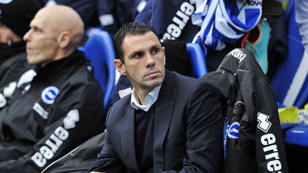 Brighton and Hove Albion's Uruguayan manager Gus Poyet looks on during the FA Cup third round at The American Express Community Stadium, Brighton, southern England on January 5, 2013. Brighton and Hove Albion sacked Poyet on Sunday night - and the Uruguayan only learned the news on live television.