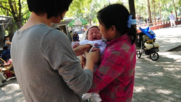 A mother and nanny tend to a baby at a park in Beijing on September 23, 2010. Human breast milk has become a new luxury for China's rich, with some firms offering wet nurse services, a report said, provoking outrage and disgust among web users Thursday.