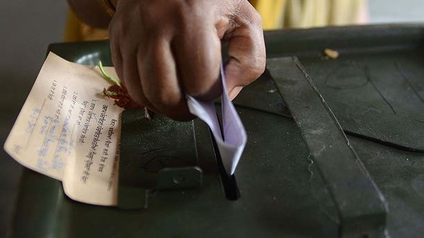 An Indian voter casts her ballot at a polling station in the village Meera Kot, on the outskirts of Amritsar, on May 19, 2013. Indian voters believe corruption has risen under the current government, but say the economy will be the most important issue in elections due next year, according to a new poll.