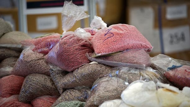 Bags of methamphetamine pills seized by the Thai narcotic police department are seen on display before being incinerated in Ayutthaya on September 17, 2011. Two Indian men have been arrested and charged in Thailand with trafficking crystal methamphetamine worth an estimated $1.4 million, a customs official said Friday.