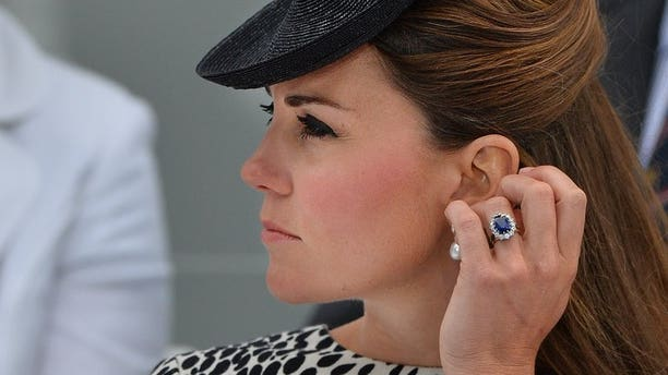Catherine, Duchess of Cambridge, pictured in Southampton, on June 13, 2013. A photographer has been charged in a probe over topless photos of Kate that appeared in a magazine, prosecutors said, the second to face scrutiny in the case.
