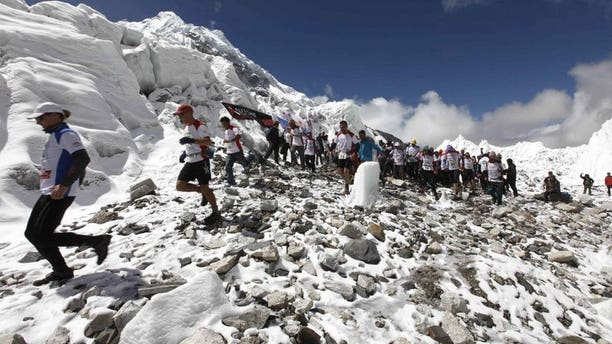 In this handout photograph released on May 29, 2013, marathon participatants are flagged off at Everest Base Camp in Nepal's Solukhumbu district. Nepal's tourism ministry said Friday it plans to exercise tighter control of climbers scaling Mount Everest to make sure they keep the world's highest peak clean and to prevent rows.