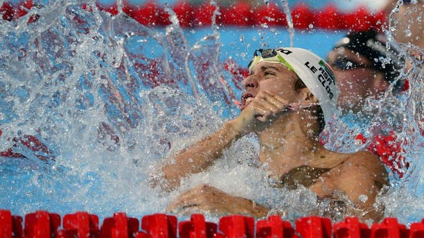 South Africa's Chad Le Clos celebrates after winning the final of the men's 100-metre butterfly swimming event in the FINA World Championships at Palau Sant Jordi in Barcelona on August 3, 2013.