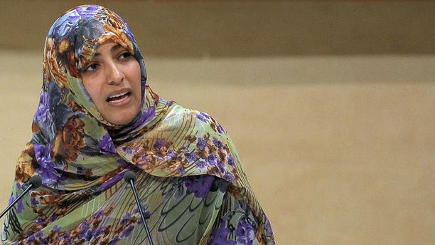 "Nobel Peace Prize winner 2011 Yemeni journalist and activist Tawakkol Karman delivers a speech in Strasbourg on October 08, 2012. Egyptian authorities banned Yemeni rights activist and Nobel Peace Prize winner Tawakkol Karman from entering the country for ""security reasons,"""