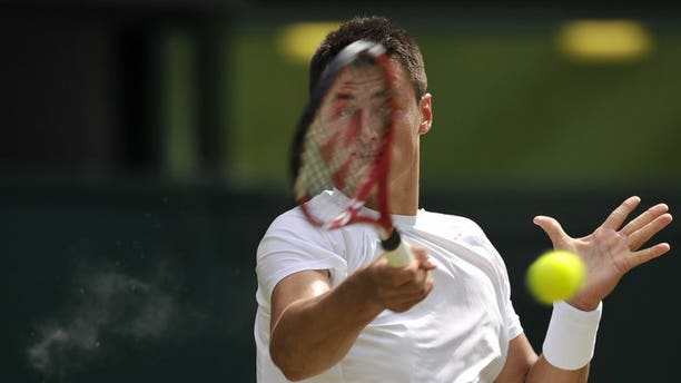 Australia's Bernard Tomic returns at the All England Club in Wimbledon, southwest London, on June 29, 2013. German Florian Mayer defeated Tomic 5-7, 6-3, 6-3 on Monday, ending the Australian's chances of playing top seed Novak Djokovic at the Montreal Masters.