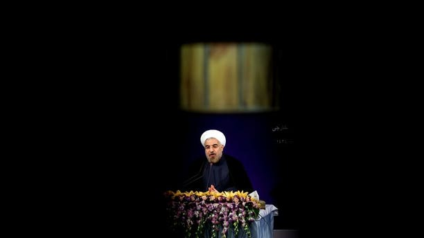 Iran's President Hassan Rowhani adresses his first news conference after taking office, in Tehran on August 6, 2013. Iran's parliament began debating on Monday the 18-member cabinet proposed by President Hassan Rowhani ahead of a vote of confidence later in the week.