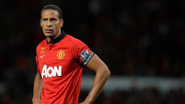 Manchester United's English defender Rio Ferdinand pictured during his testimonial match against Sevilla at Old Trafford in Manchester, northwest England on August 9, 2013. Ferdinand claims that the current national side have lost their identity and has called for an overhaul of the national coaching strategy.