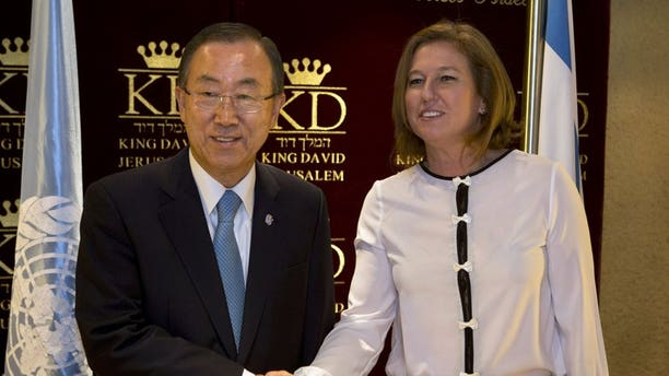 """Israeli Justice Minister Tzipi Livni (right) greets Ban Ki-moon in Jerusalem on Friday. The UN chief called on Israelis and Palestinians on Friday to overcome """"deep scepticism"""" that he said risked thwarting efforts to reach a peace agreement."""