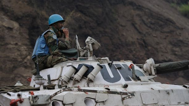 Peacekeepers operating as part of the United Nations Stabilisation Mission for the Congo (MONUSCO) wait in Munigi on July 19, 2013. More than 80 children, some as young as eight years old, have been rescued from an armed group in the southeastern Democratic Republic of Congo and are being reunited with their families, the UN said Friday.