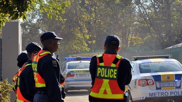 File picture shows police standing guard in Johannesburg on May 27, 2010. South African police arrested a housekeeper after a break-in at the upmarket Johannesburg home of controversial Indian moguls closely linked to President Jacob Zuma.