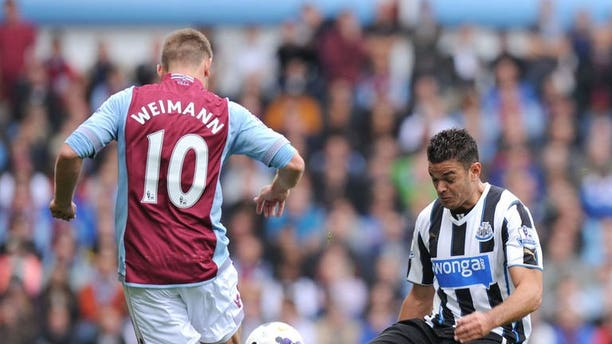 Aston Villa's Austrian forward Andreas Weimann (L) vies with Newcastle's French midfielder Hatem Ben Arfa (R) during the English Premier League football match between Aston Villa and Newcastle United at Villa Park in Birmingham, West Midlands, England, on September 14, 2013. Newcastle won 2-1.