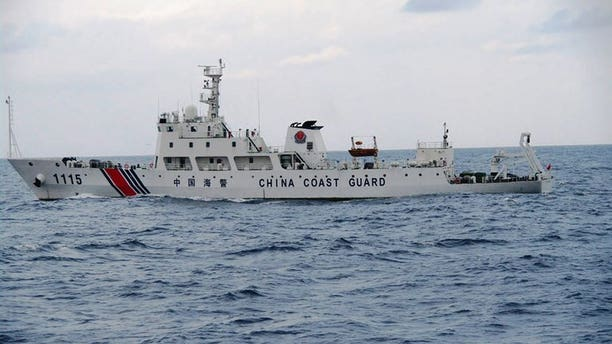 A Chinese coastguard ship is pictured on September 5, 2013 cruising near the disputed islets, known as the Senkaku islands in Japan and Diaoyu islands in China, in the East China Sea.