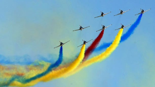 File picture shows an air demonstration team pictured during an air show at the Changchun First Aviation Open Day in Changchun, in northeast Chinas Jilin province, on September 1, 2011.