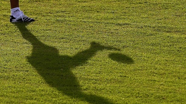 The shadow of a footballer is seen on the field in Barquisimeto, Venezuela on July 6, 2007. A Malaysian football club suspended all of its coaches and officials for two weeks Monday over suspected match-fixing following a series of heavy defeats