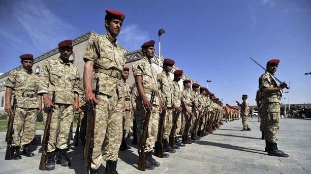 Yemeni soldiers parade during the funeral of victims of bombing attacks on the Gulf of Aden on September 22, 2013 in Sanaa. Unidentified gunmen shot dead on Tuesday a Yemeni air force officer in the capital, the second killing of its kind in less than 24 hours, a military official said.