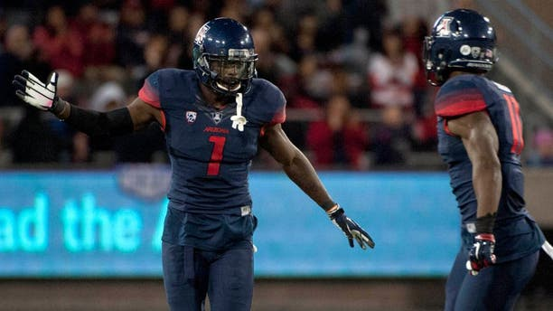 Nov 14, 2015; Tucson, AZ, USA; Arizona Wildcats safety Tellas Jones (1) and safety Will Parks (11) celebrate after a fumble recovery during the fourth quarter against the Utah Utes at Arizona Stadium. Arizona won 37-30 in double overtime. Mandatory Credit: Casey Sapio-USA TODAY Sports