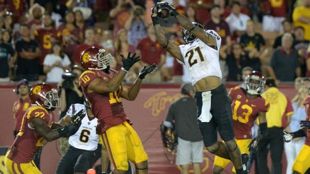 Oct 4, 2014; Los Angeles, CA, USA: Arizona State Sun Devils receiver Jaelen Strong (21) catches a 53-yard touchdown pass while defended by Southern California Trojans linebacker Hayes Pullard (10) on the final play of the game at Los Angeles Memorial Coliseum. Arizona State defeated USC 38-34. Mandatory Credit: Kirby Lee-USA TODAY Sports