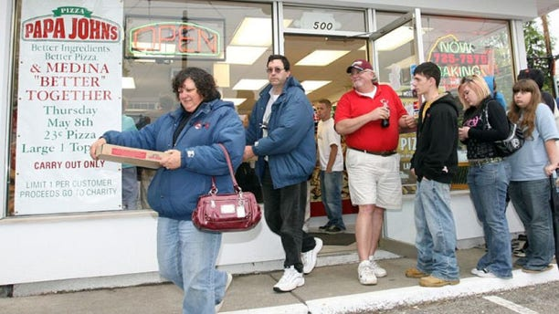 FILE: People leave a Papa John's store with pizzas they purchased for 23 cents in Medina Ohio