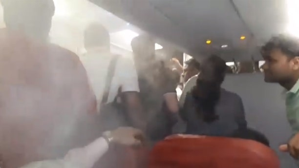 A passenger claims the crew on an AirAsia flight used the AC on full blast to force people off the plane after a long delay.