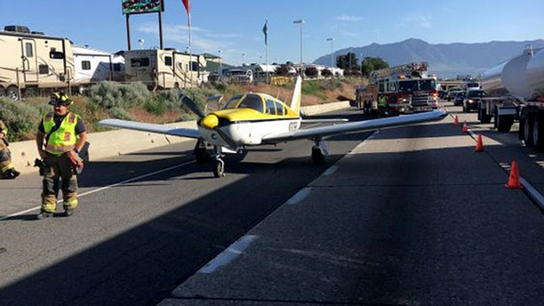A single engine airplane experienced mechanical issues and reportedly lost power before landing on the I-15 in Utah.