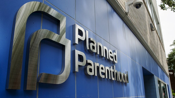 A sign is pictured at the entrance to a Planned Parenthood building in New York August 31, 2015. Picture taken August 31, 2015. To match Insight USA-PLANNEDPARENTHOOD/   REUTERS/Lucas Jackson  - GF10000188426