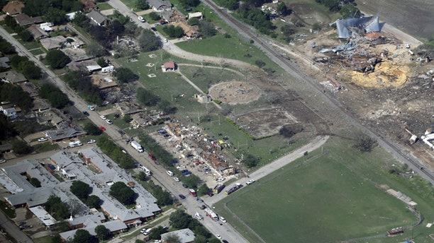 April 18, 2013:  The remains of a nursing home, left, apartment complex, center, and fertilizer plant, right, that were destroyed by an explosion in West, Texas are seen in this aerial photo.