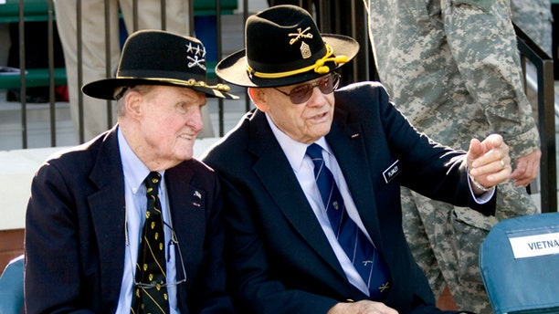 In a March 19, 2009 photo, retired Command Sgt. Maj. Basil L. Plumley, right, and retired Lt. Gen. Hal Moore, left, who served together with the 1st Cavalry Division in the Ia Drang Valley, talk at the National Infantry Museum and Soldier Center in Columbus, Ga.