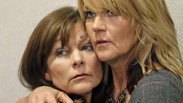 Sept. 19, 2014: Susan Hunt, left, the mother of Darrien Hunt, is hugged by her sister, Cynthia Moss, during a news conference in Salt Lake City. (AP)