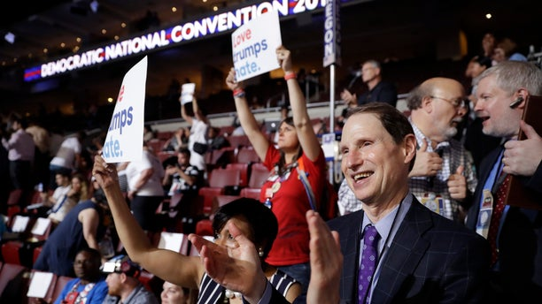 In this July 25, 2016, file photo, Sen. Ron Wyden, D-Ore., applauds during the first day of the Democratic National Convention in Philadelphia. Penn. A frequent critic of the pharmaceutical industry, despite receiving more than $40,000 from opioid drugmakers to his campaigns and his leadership PAC in the past decade, Wyden proposed eliminating the exemption and using the $75 million to fund addiction treatment for low-income pregnant women, who must forfeit their Medicaid prenatal coverage before seeking treatment.