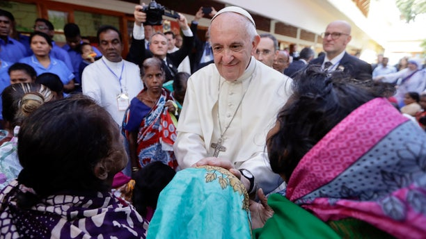 Pope Francis meets with sick people and staff of the Mother Teresa House in Dhaka's Tejgaon neighborhood, Bangladesh, Dec. 2, 2017.