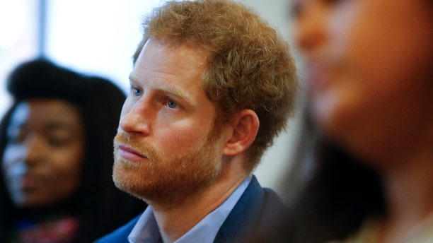 This is a Monday, Dec. 19, 2016 file photo of Britain's Prince Harry listens to a seminar for members of staff during a visit to the Mix in London.
