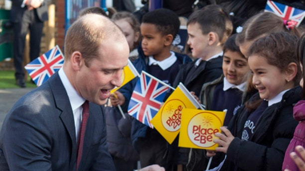 Britain's Prince William arrives with his wife Kate, Duchess of Cambridge to attend the Place2Be Big Assembly as part of the Heads Together campaign marking children's mental health week at the Mitchell Brook Primary School, north London, Monday Feb. 6, 2017. (Ian Vogler/Pool via AP)