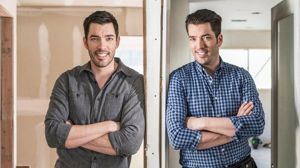 """The """"Property Brothers"""" pose for an HGTV photo. A new show titled """"Drew's Honeymoon House"""" will hit the air in November 2017."""