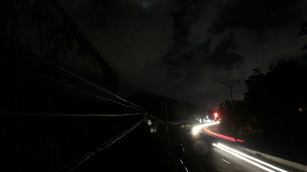 Help from U.S. mainland power companies has been coming in waves for months. But some Puerto Rico residents say they still haven't seen a light come on anywhere in their neighborhood since the hurricanes hit last fall.