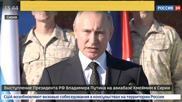 Russian President Vladimir Putin addresses to the troops at the Hemeimeem air base in Syria.