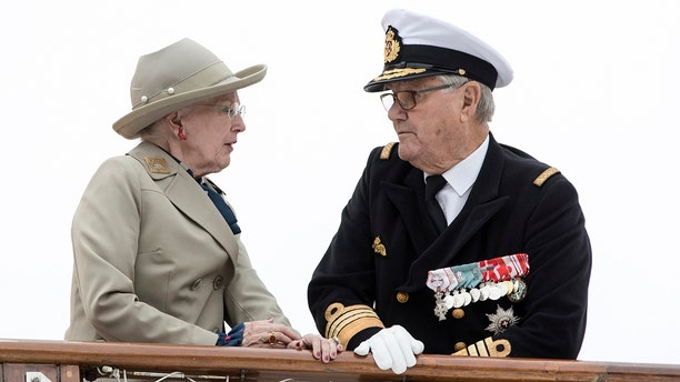 Danish Queen Margrethe and Prince Henrik arriving to Aarhus Harbour aboard the Royal Yacht Dannebrog in June