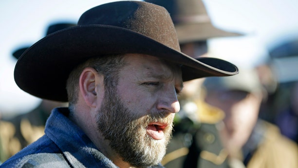 Ammon Bundy speaks with reporter at a news conference at Malheur National Wildlife Refuge Friday, Jan. 8, 2016, near Burns, Ore. Bundy, the leader of an armed group occupying the national wildlife refuge to protest federal land management policies, said Friday he and his followers are not ready to leave even though the sheriff and many locals say the group has overstayed their welcome. (AP Photo/Rick Bowmer)