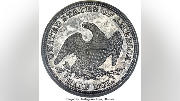 This undated provided available by Heritage Auctions shows a 1838 half-dollar minted in New Orleans in 1838 that went up for auction at the annual Florida Numismatic Convention in Tampa, Fla., this week. The coin is one of the rarest and most enigmatic coins in U.S. history. Only 10 examples are known to exist in the world. (Heritage Auctions via AP)