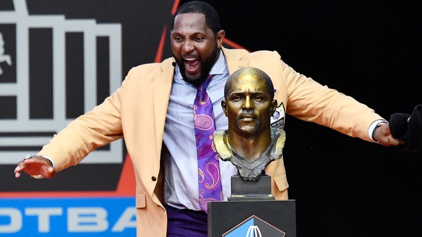 Former Baltimore Ravens linebacker Ray Lewis dances beside his bust as he delivers his induction speech at the Pro Football Hall of Fame in Canton, Ohio, Aug. 4, 2018.