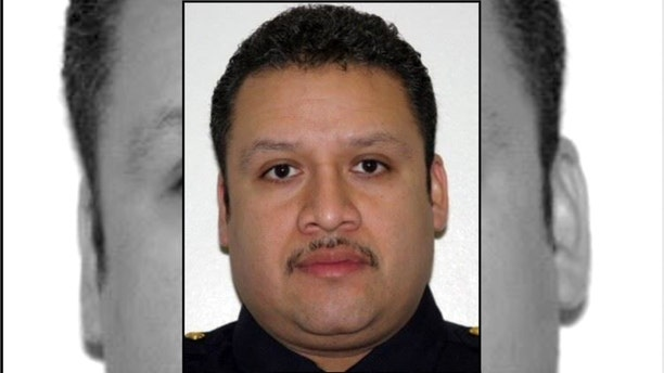 """The State Police tweeted a photo of the fallen officer saying, """"Our thoughts and prayers are with Jersey City PD and the family of Lieutenant Christopher Robateau."""""""