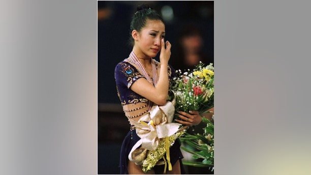 Fifteen-year-old Michelle Kwan of the United States cries on the podium after winning the gold medal at the World Figure Skating Championships March 23 in Edmonton.  WORLD FIGURE SKATING - RTRE4F