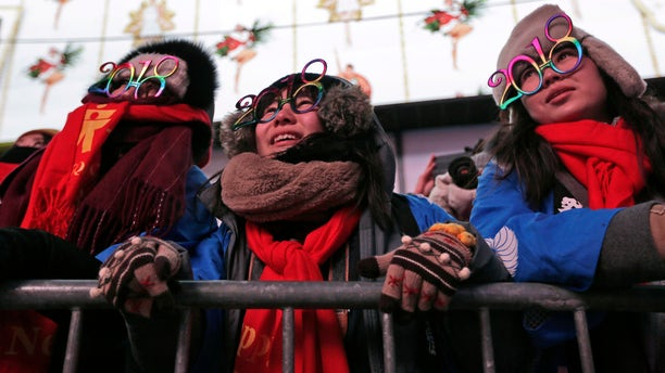 Revelers watch rehearsals of New Year's celebrations in Times Square, New York City, Dec. 31, 2017.