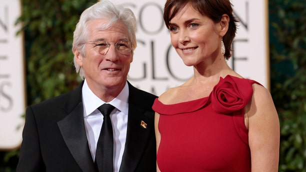 "Actor Richard Gere of the film ""Arbitrage"" and his wife Carey Lowell at the 70th annual Golden Globe Awards in Beverly Hills, California January 13, 2013."