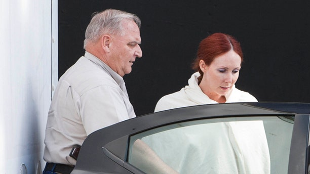 June 7, 2013: In this file photo, Shannon Richardson is placed into a Titus County Sheriff's car after an initial appearance at the federal building Texarkana, Texas.
