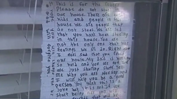 The letter taped to the window.
