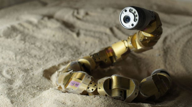 The Carnegie Mellon snake robot has finally mastered the art of slithering up a sandy slope.