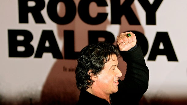 """U.S. actor Sylvester Stallone poses as he arrives for the British premiere of his latest film """"Rocky Balboa"""" at The Vue Cinema in London's Leicester Square January 16, 2007.   REUTERS/Dylan Martinez    (BRITAIN) - RTR1L9NU"""