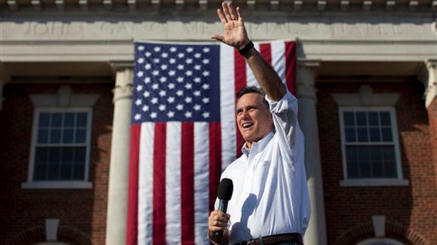 March 13, 2012: Mitt Romney waves during a campaign stop at William Jewell College in Liberty, Mo.