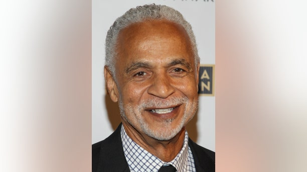 Actor Ron Glass arrives at the Emmy Awards in 2013